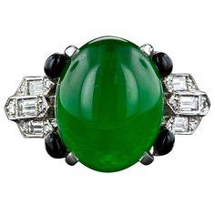 Art Deco Imperial Jadeite and Diamond Ring. Imperial jade, black onyx and diamond set in platinum.