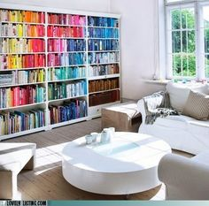 I think the idea of cataloging books by color adds a sense of unity to a space.