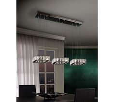 LED lamp made of metal, stainless steel and faceted crystal pieces. Adjustable in height.