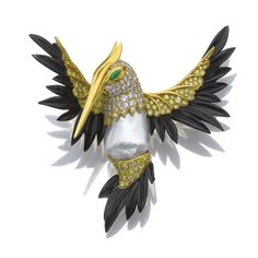 CULTURED PEARL, EMERALD, ONYX AND DIAMOND BIRD OR HUMMINGBIRD BROOCH, BY HEMMERLE.