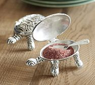 i love cooking and i always thought i would feel like a real cook if i had cool spice holders like these little guys!
