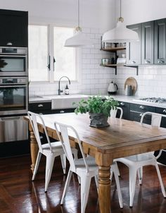 black and white kitchen with wood tones