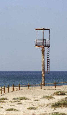 Abandoned lifeguard tower Cabo de Gata Spain(It may be the poster child for low-maintenance lifeguard infrastructure but even ultra-minimalist installations need a little TLC now and then… and this one's not getting any. Is the problem a lack of lifeguards or an improvement in tourists' swimming skills)