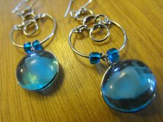 'Sea Blue Glass Wire Wrapped Earrings' is going up for auction at 12pm Tue, Aug 14 with a starting bid of $3.