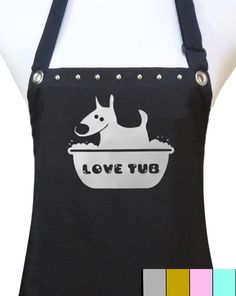 """Dog grooming waterproof salon apron made from durable middleweight polyester. It features a thick undercoating of polyurethane which is soft and flexible. Fully adjustable waist and neck. Two flap pockets. One size fits most. Measures 28"""" x 28"""". Long waist ties measure 36""""."""
