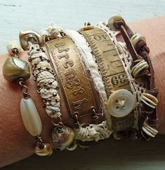 Nina Bagley, vintage assemblage bracelets, Jewelry wrap strength on wrist  LOVE the old sewing tape measure