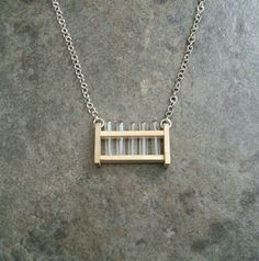 Bring the lab with you by wearing this tiny test tube rack necklace
