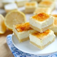 Lemon Cheesecake Creme Brûlée Bars.  Could you have 3 things that taste better all in one bite size bar?!