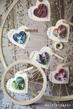 Cute display using bicycle wheels to display crayon valentines... OR cards cut to the shape of the beads