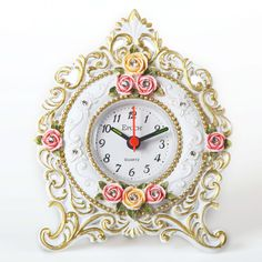 Features:  -Made in USA.  -Conspicuous red hand.  -Rococo style with rose relief.  -1 AA batteries.  -Luminous-in-dark hands.  Product Type: -Tabletop.  Style: -Traditional.  Time Display: -Analog. Di