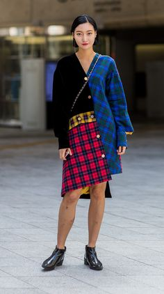 This Seoul Fashion Week show-goer has got all the tartan going on in her cute-as coat dress