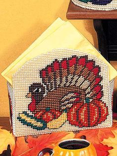 Plastic Canvas - Accessories - Stitched on plastic canvas with worsted weight yarn. Size: Cheery Thanksgiving napkin holder measures x Skill Level: Beginner - Plastic Canvas Coasters, Plastic Canvas Ornaments, Plastic Canvas Tissue Boxes, Plastic Canvas Crafts, Free Plastic Canvas Patterns, Craft Patterns, Stitch Patterns, Free Pattern Download, Needlepoint Stitches