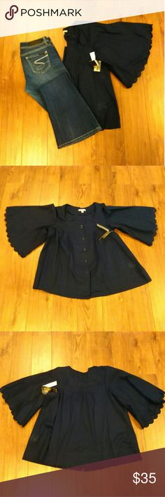 NWT  Joe's Jeans Navy Button Front Top Size L Joe's Jeans Navy Blue Button Front Top Size L   Scalloped Sleeves Pleated Front  100% Cotton  Please Check Out My Other Items  #105  Jean's Sold Separately Joe's Jeans Tops Button Down Shirts