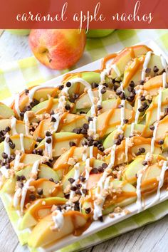 These Caramel Apple Nachos are an easy treat perfect for movie nights and get togethers. Sliced apples drizzled in caramel and white chocolate, and topped with chocolate chips and toffee bits - it tastes just like a caramel apple, but simpler to make! Fall Dessert Recipes, Apple Desserts, Fall Desserts, Apple Recipes, Fall Recipes, Appetizer Recipes, Delicious Desserts, Fruit Recipes, Dove Recipes