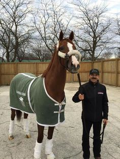 California Chrome and Raul Rodriguez.  Wins the Dubai World Cup. Wealthiest racehorse in North America.