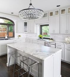 Grey and white kitchen with modern chandelier