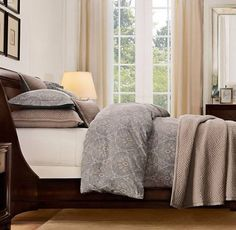 I like the look and colors of this for the master bedroom.  The duvet cover is Italian Cypress Paisley in Eucalyptus from Restoration Hardware.