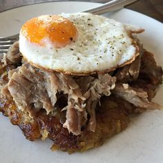 """""""Stacked breakfast of champions. First layer is @thepaleomom recipe for plantain and apple fritters. I made it into one big thick fritter. Second layer is leftover Kalua pig from @nomnompaleo all topped with a soy free, free range egg. #Paleo #aip #autoimmunepaleo #autoimmunedisease #paleohope #breakfastisforwinners #cleaneating #dairyfree #eatrealfood #freerangeeggs #grainfree #glutenfree #healthyfood #jerf #kaluapig #kaluapork #nutfree #organic #primal #paleomom #paleobreakfast #soyfree"""