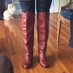 Coach boots Sz 7.5 Authentic brown Coach boots. Size 7.5. Worn. Had taps put on the heels to keep in good condition and from wearing down. Coach Shoes Over the Knee Boots