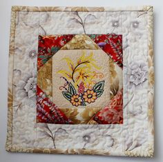 Patchwork quilted and embroidered floral mugrug by StephsQuilts