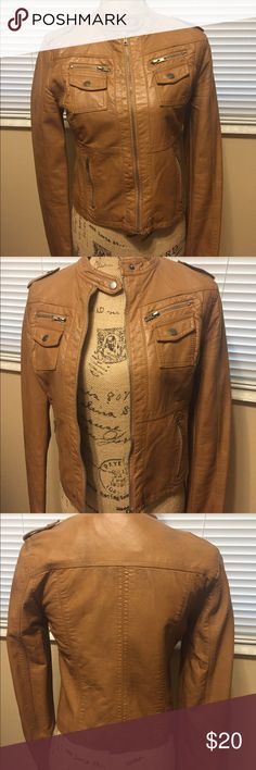 Xhilaration Faux Leather Jacket Biker style jacket.  Brown, tan, caramel color.  Zipper up the front of the jacket, two button pockets up top with Zipper closer above and two side zipper pockets.  This jacket also has zippers on the cuffs.  See pics.  Nice condition, seldom worn. Xhilaration Jackets & Coats