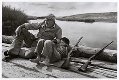 [Ernest Hemingway and son Gregory relax during a day shooting pheasant, Sun Valley, Idaho]