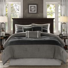 Transform the look of your bedroom with this elegant seven piece bedding set. This collection features a luxurious microsuede finish and a black and grey colorblock design. This chic bedding set inclu
