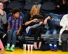 Henry Samuel, Heidi Klum and Johan Samuel attend a basketball game between the New Orleans Pelicans and the Los Angeles Lakers at Staples Center on April 1, 2015 in Los Angeles, California.