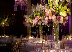 Purple, green, and white wedding reception centerpieces
