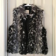 Black, Grey, and White Fur Vest Multi-colored fur vest. Worn once. Great condition. Urban Outfitters Jackets & Coats Vests