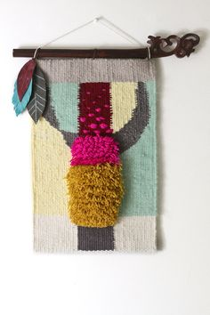 This OOAK tapestry wall hanging features playful design:    -Will add texture to any home with its classic shag woven design.    - A variety of yarns