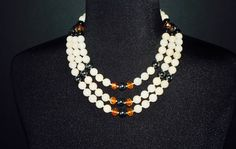 A personal favorite from my Etsy shop https://www.etsy.com/listing/384854108/custom-made-multiple-strand-tangerine