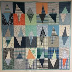utilityquilts: A baby/toddler quilt for my new grandson made with fabrics from shirts, crib sheets, and a couple of remnants.