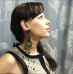 Svetlana is having fun trying on our Paradox statement earrings at Inspiration kz. #DoriCsengeri #earrings #statement #longearrings