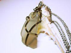 #Nautical Jewelry,Wrapped Sea Glass,Nautical Pendant,Wire Wrapped Pendant,Sea Glass Jewelry,Pale Cola Colored Sea Glass,Cape Cod Sea Glass,      Wonderfully and Interestingl... #seaglass #seaglaspendant #nauticalnecklce #gift #giftidea #giftforher #fashion Nautical Pendants, Nautical Jewelry, Nautical Style, Seashell Jewelry, Sea Glass Jewelry, Anchor Earrings, Curved Glass, Wire Wrapped Pendant, Glass Pendants
