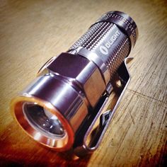 Olight S1 Baton Polished Titanium Flashlight