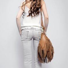 Gotta love a good fringe.  My sister used to have one just like this-I borrowed it all the time!