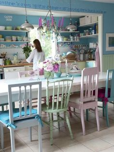 Pastel kitchen. Love the different chairs!