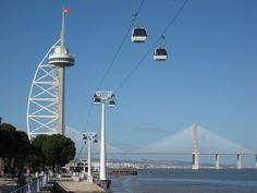 Cable cars near the Vasco de Gama Tower in Lisbon, Portugal.