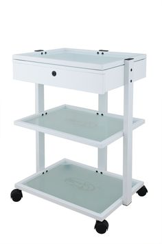 This European trolley Is convenient and versatile with a locking drawer on top to storage products ans supplies, and two glass tempered shelves to fit your spa equipment  $209.00 www.salonandspadepot.com