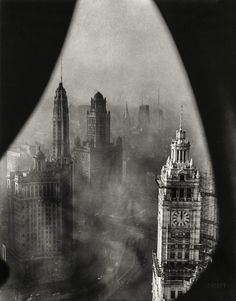 "burnedshoes: ""© Underwood & Underwood, Nov. 1, 1952, Low Noon, Chicago Chicago framed by Gothic stonework high in the Tribune Tower. This view of Chicago's downtown shows the low-lying smog which blanketed the area one recent morning. In the..."