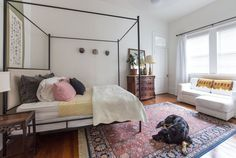 living room: Megan and Sam's Mix of Antiques and Art with a New Orleans Speakeasy Past