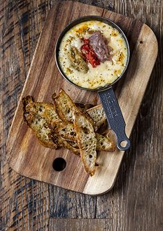 Baked tetilla cheese with escalivada - This recipe comes from Lobos tapas bar in Borough Market. Tetilla is a Spanish cheese available from delis and online. This dish takes just 30 minutes to prepare, is really easy and vegetarian. It's great as part of a sharing spread