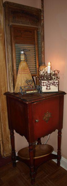 little side table, old wash boards, little whisk broom