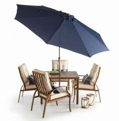Get a rich, classic beach feel with a navy blue and natural medium brown dining set.