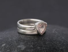Pretty rose quartz trillion wedding set in satin finished sterling silver. Stone is 8mm across  This ring is made to order. Please let me know your ring size when you place your order.  Your ring will come in a black gift box with a black bow.  FREE SHIPPING  To visit my shop, please go to https://www.etsy.com/shop/williamwhite  All jewellery is hand made by me in Cornwall, south-west England