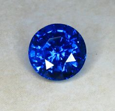 Rare Large Round Fine Glowing Deep Blue Sapphire weighing  3.75cts