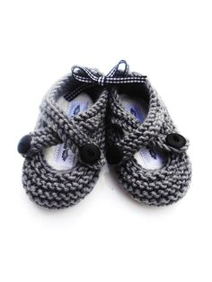 merino knitted baby booties : silver grey, hand knitted, hand printed gift bag, scented insoles. $24.00, via Etsy.