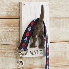 Are you guilty of tossing your dogs leash on the floor after your walks, just because you dont have anywhere to hang it? Your floor could be clutter free with our adorable Dog Tail Leash Holder. This whimsical leash hanger features a cast iron dog tushie on painted, distressed wood with WALK caption. It comes with mounting hardware for easy installation.