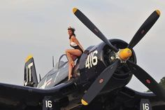 1940's Style Navy Pin-Up Girl Sitting on a Vintage Corsair Fighter Plane Photographic Print